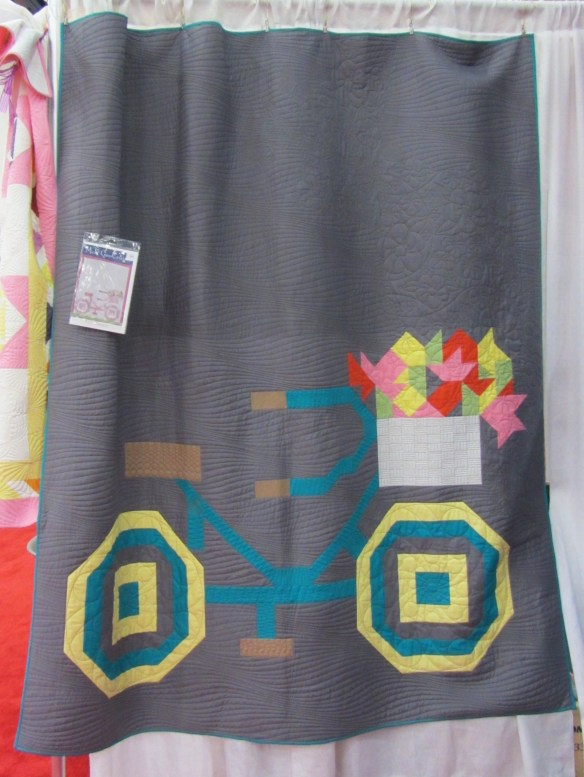 Love the graphic look of this bicycle quilt.  Sorry I didn't write down the company who featured it in their booth.