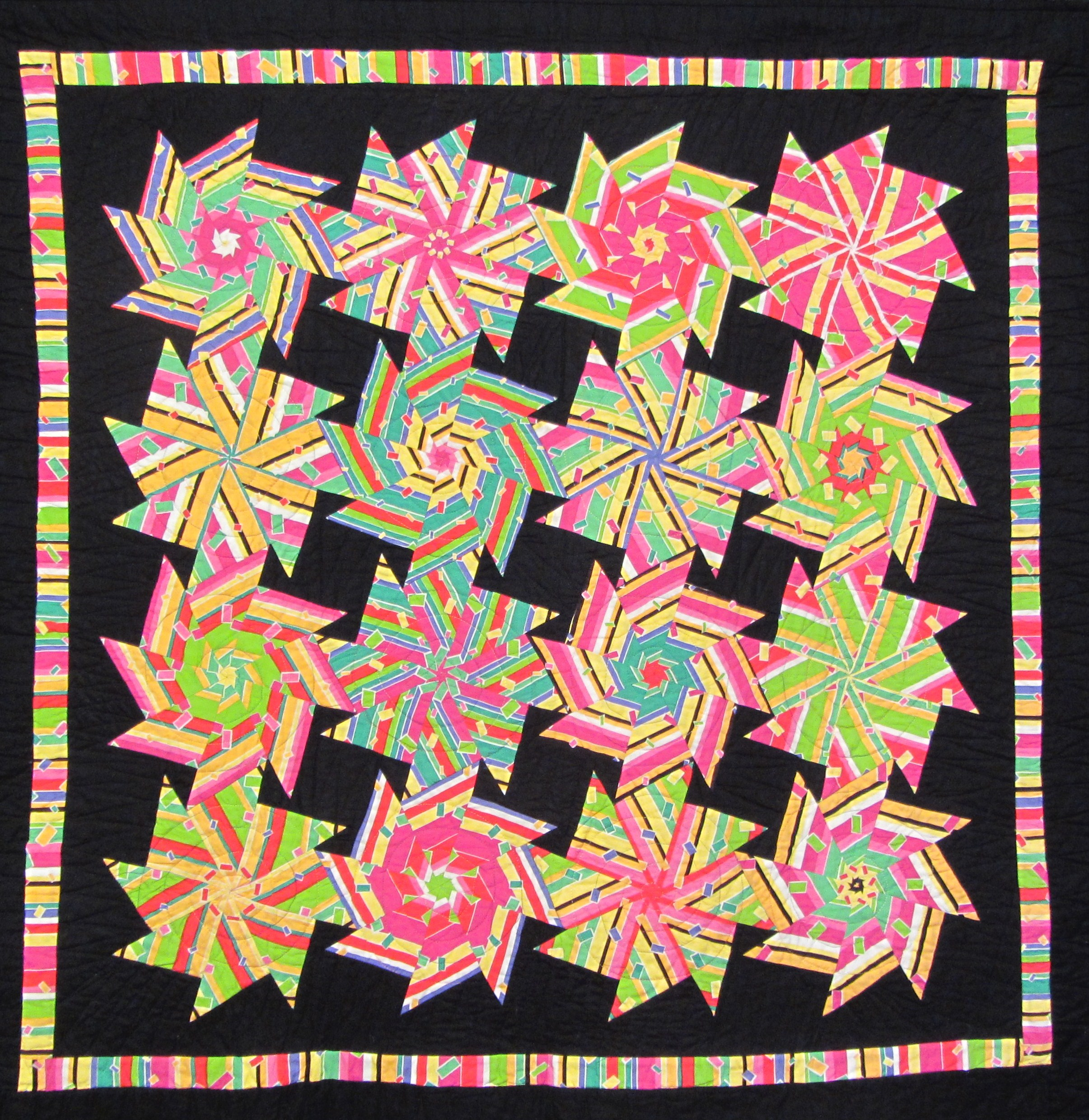 Exuberance by Wendy Starn - a windmill block cut using the stack & whack method
