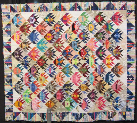 Fish Scraps by Rahna Summerlin.  Inspired by a vintage fish quilt.  Almost all the fabrics are from surf wear industry ready-to-wear fabric samples & remants