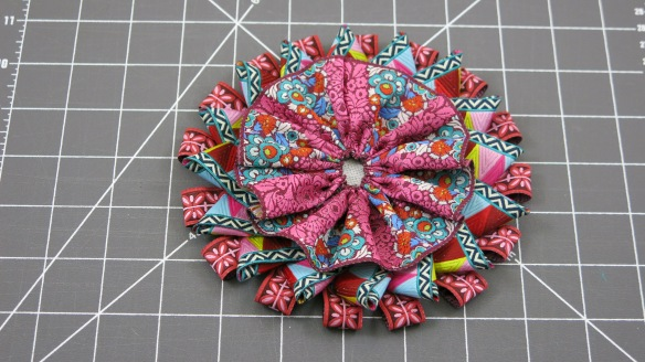 The Third Layer is a Gathered Ribbon Rosette Stitched to the Center to Cover all the Ends of the Ribbon Loops