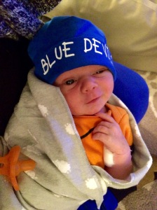 Here's Ollie, born 2/28/15, just in time for March Madness! One week old and sporting his Duke Blue Devils hat.